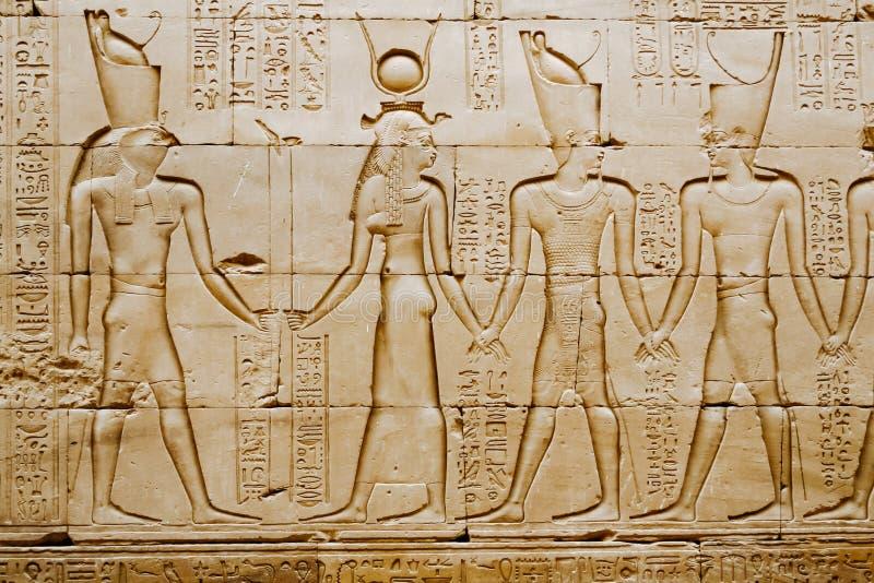 Reliefs of Egyptian hieroglyphs on wall at Horus Temple. Edfu. stock photography