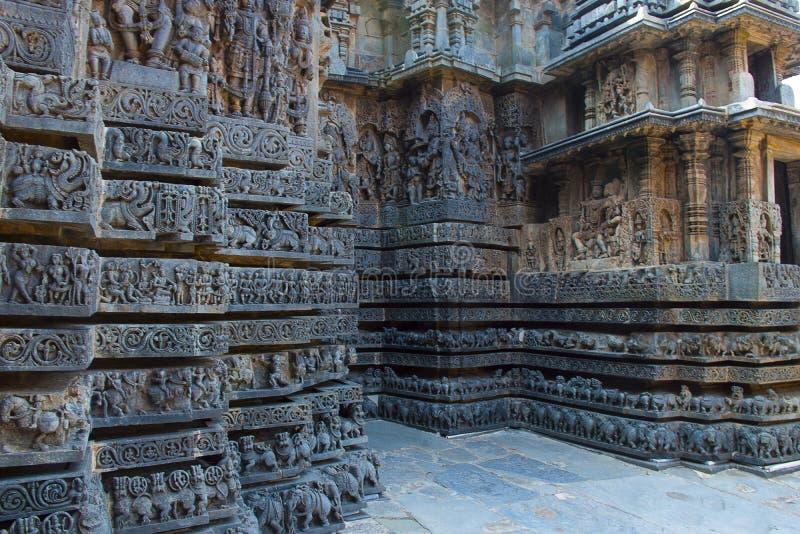 Reliefs on the outer wall of the Hoysaleswara Temple. Hoysala style, Halebidu, Karnataka royalty free stock photography