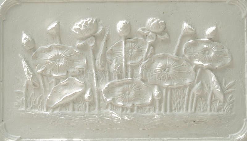 Relieft dello stucco di Lotus immagine stock