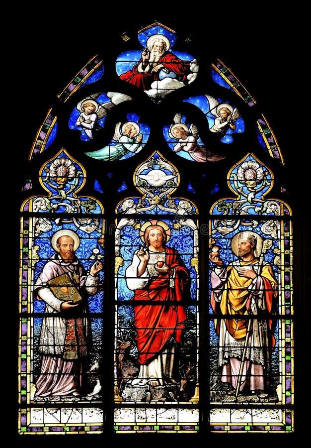 Religiöses Buntglaswandgemälde stockfotografie