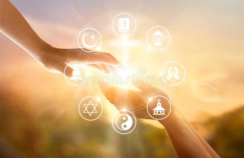 Religion concept. Human hands together forgives and blesses. Praying and religions icon on sky sunset background royalty free stock photo