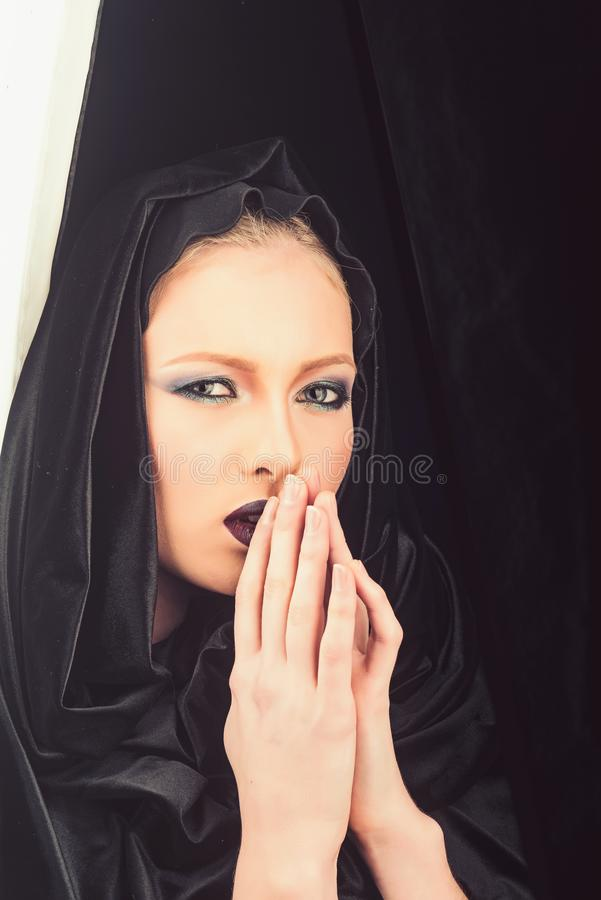 Religion and death concept. madonna woman in black hood. Makeup look and skincare sensual of girl. Fashion model royalty free stock image
