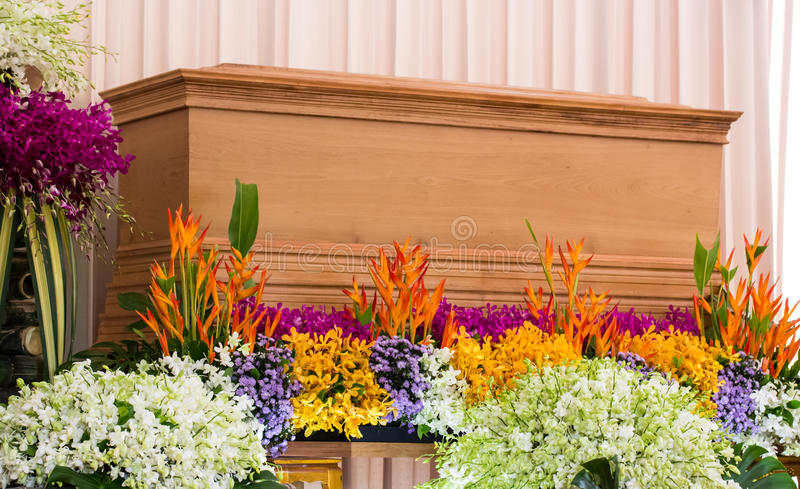 Religion, death and dolor - funeral and cemetery. Funeral with coffin with flowers stock images