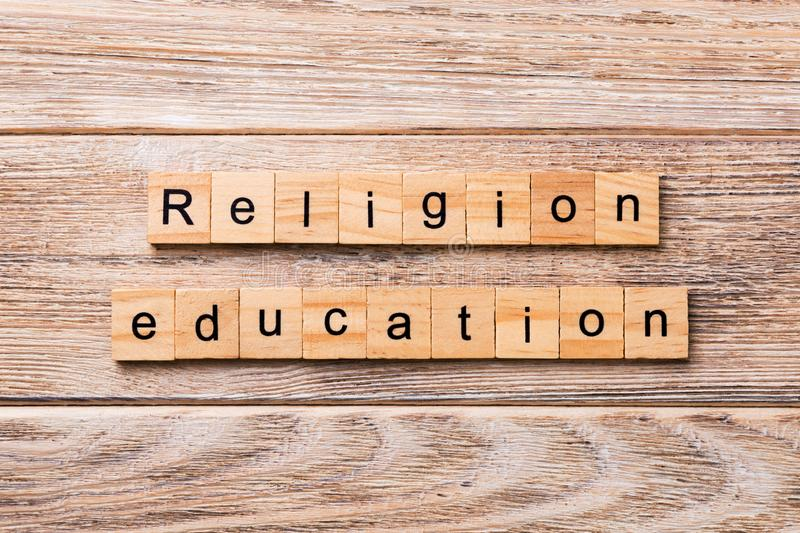 Religion education word written on wood block. religion education text on wooden table for your desing, concept.  royalty free stock image