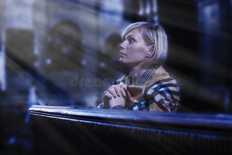 Religion, faith, meditation concept. Portrait of a beautiful woman praying in churches. Religion, faith, meditation concept. Portrait of a beautiful woman stock image