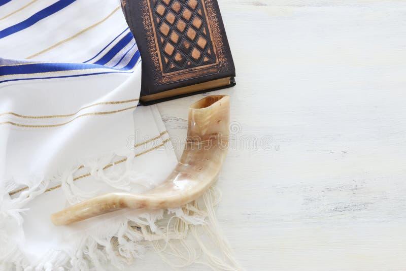 Religion image of Prayer Shawl - Tallit, Prayer book and Shofar horn jewish religious symbols. Rosh hashanah jewish New Year. Holiday, Shabbat and Yom kippur stock photos