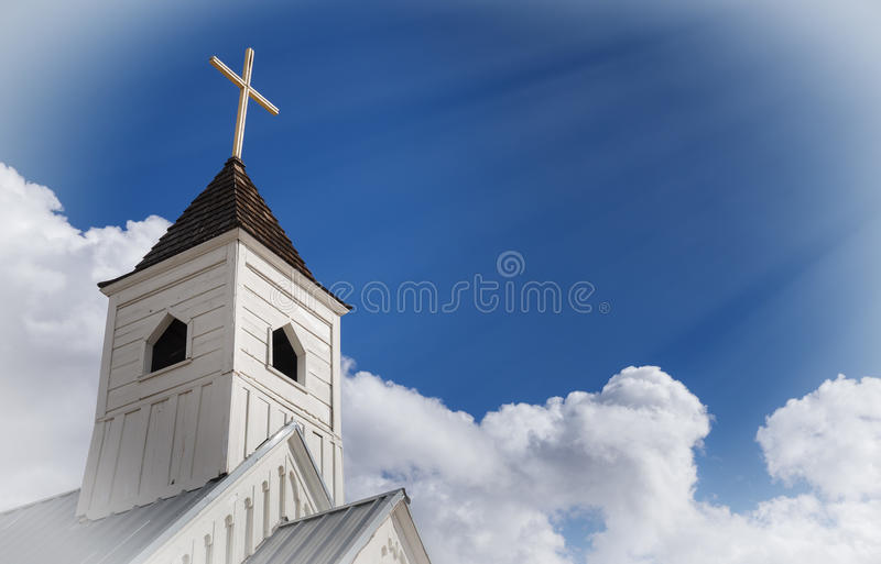Religion and spirituality concept image. Rays from sun beam down on cross. stock photography
