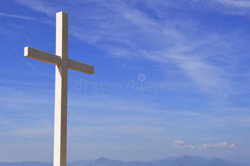 Religion wooden cross against the blue sky. Religion wooden cross against the blue sky royalty free stock photography