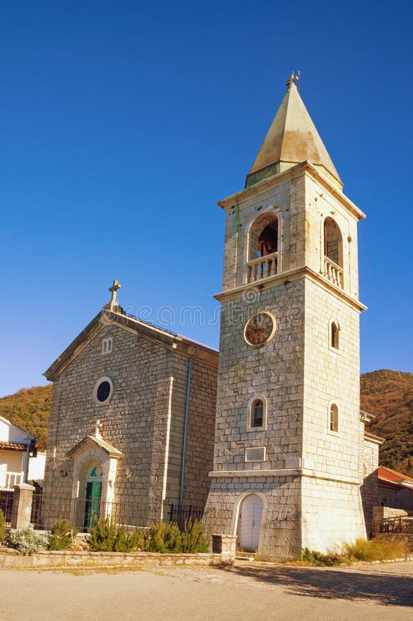 Religious architecture. Montenegro, Tivat. View of Catholic Church of Saint Roch in Donja Lastva village on sunny winter day. Religious architecture. Village royalty free stock image