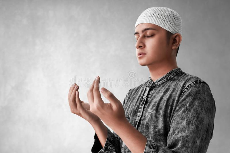 Religious asian muslim man praying. To god stock photo