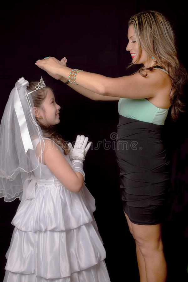 Religious Blessings. Mother blessing her child during a religious ceremony royalty free stock images