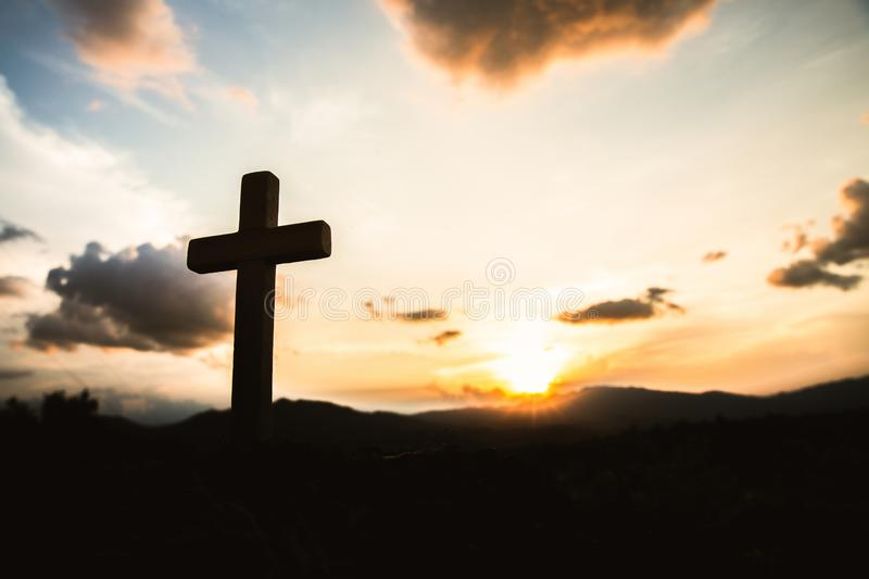 Religious concepts. Christian wooden cross on a background with dramatic lighting,  Jesus Christ cross, Easter, resurrection. Concept. Christianity, Religion stock images
