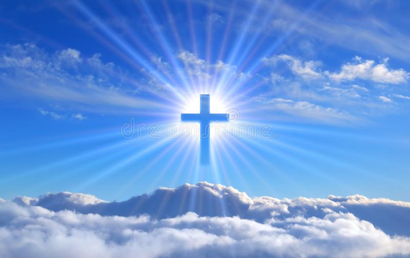 Religious cross over cumulus clouds illuminated by the rays of holy radiance, concept. stock image