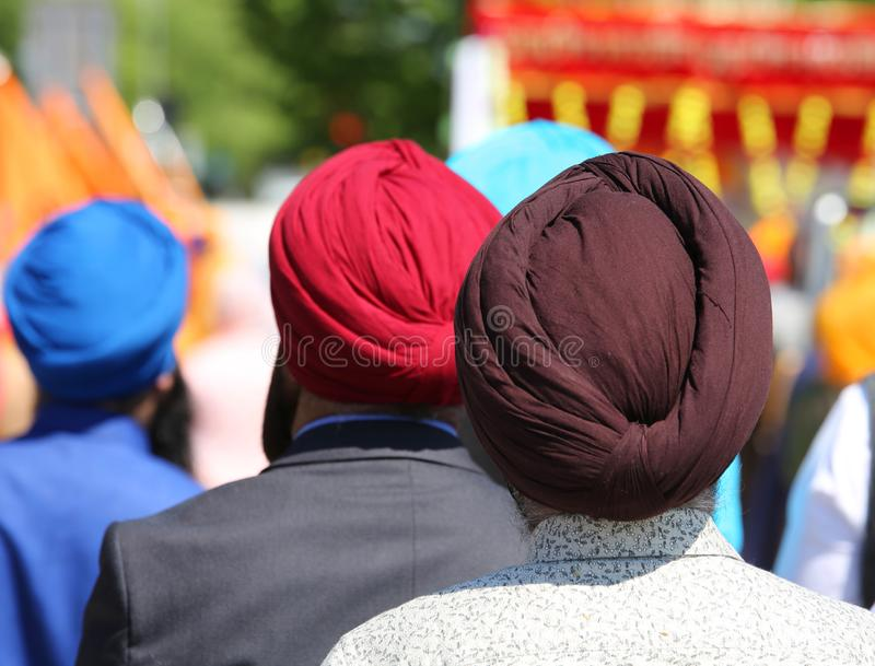 Religious event with men who wear turbans. Dyes stock images