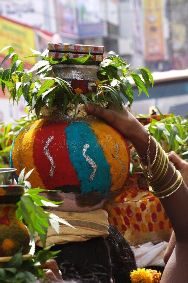 Religious Festival ,Bonalu ,India. Devotee offers puja at Secunderabad Sri Ujjaini Mahakali Temple stock images