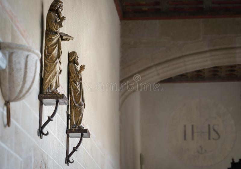 Religious figures hanging on the wall of an old convent cloister. In Plasencia, Extremadura, Spain royalty free stock photos