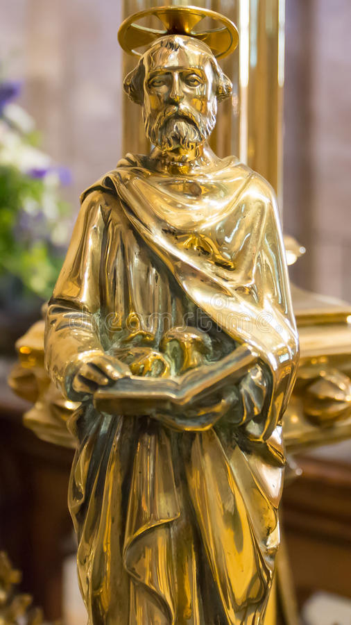 Religious Figurine. A brass religious figurine in a church stock images