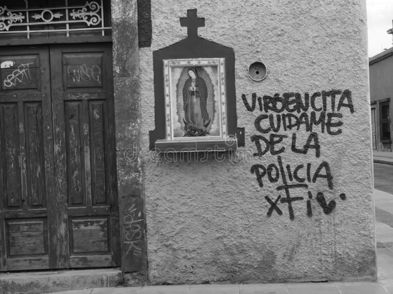 Religious icon of Mother Mary in Mexico, catholic religion, with social commentary stock image