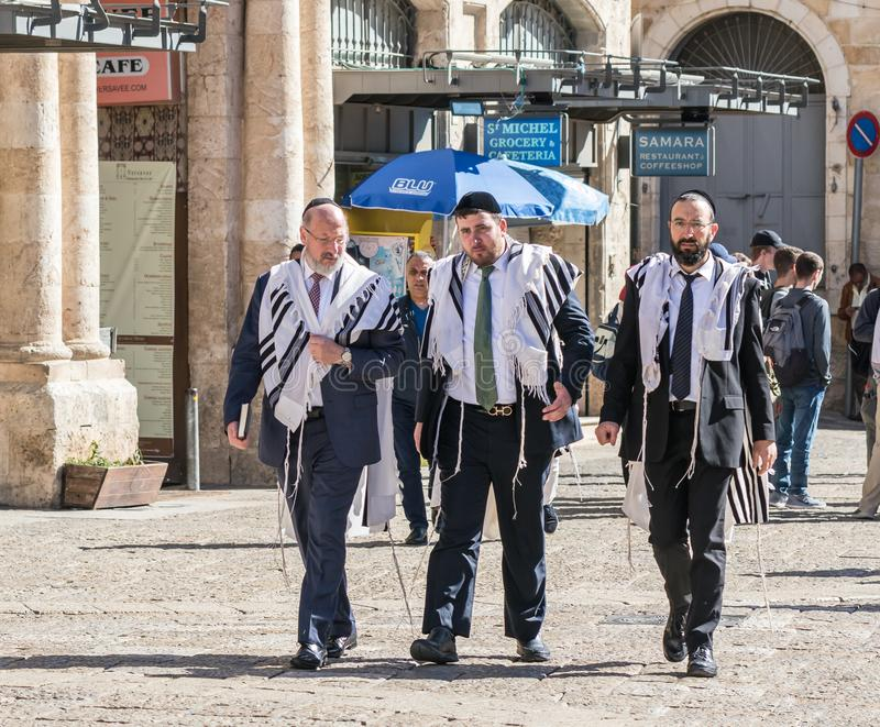 Religious Jews walk on a street near Jaffa Gate in the old city of Jerusalem, Israel. Jerusalem, Israel, March 09, 2019 : Religious Jews walk on a street near royalty free stock images