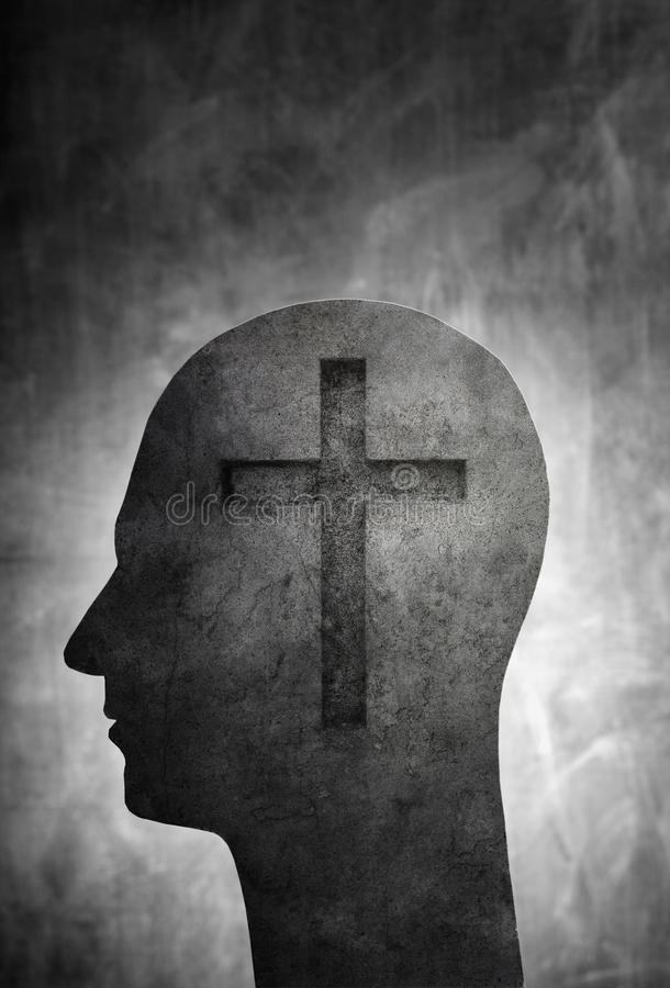 The Religious Man. Conceptual image of a head with a christian cross symbol royalty free stock photography