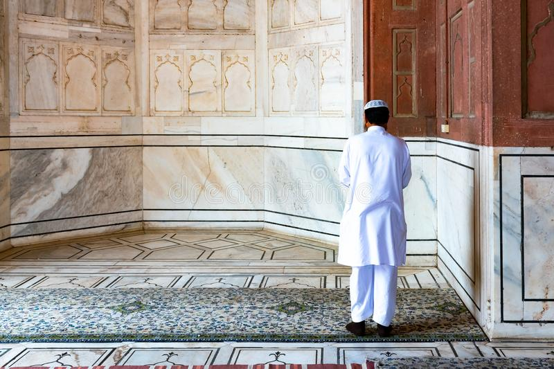 Religious muslim man praying inside the mosque, New Delhi, India stock image