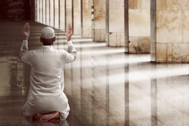 Religious muslim man praying royalty free stock images