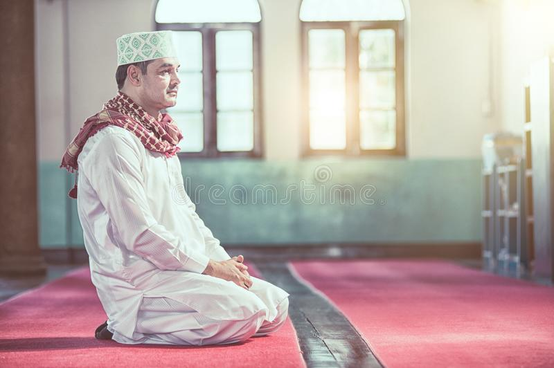 Religious muslim man praying inside the mosque royalty free stock photos
