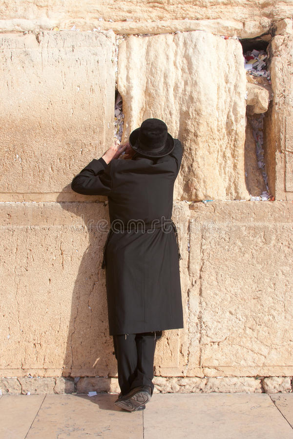 A religious orthodox prays at the Wailing Wall stock photography