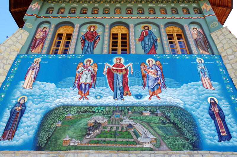 Orthodox church. Religious painting on the wall with Virgin Mary - Monastery Bujoreni, Vaslui County, landmark attraction, Romania. Orthodox church. Religious stock photography