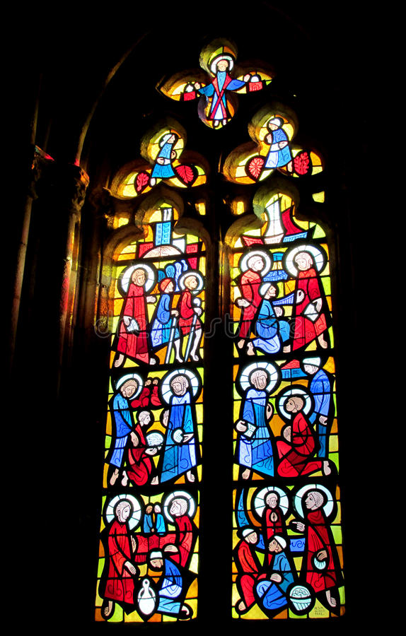 Religious picture on stained glass in the church. Black glass with ornaments and images of Catholic christian religious subjects, stories from Bible in royalty free stock image