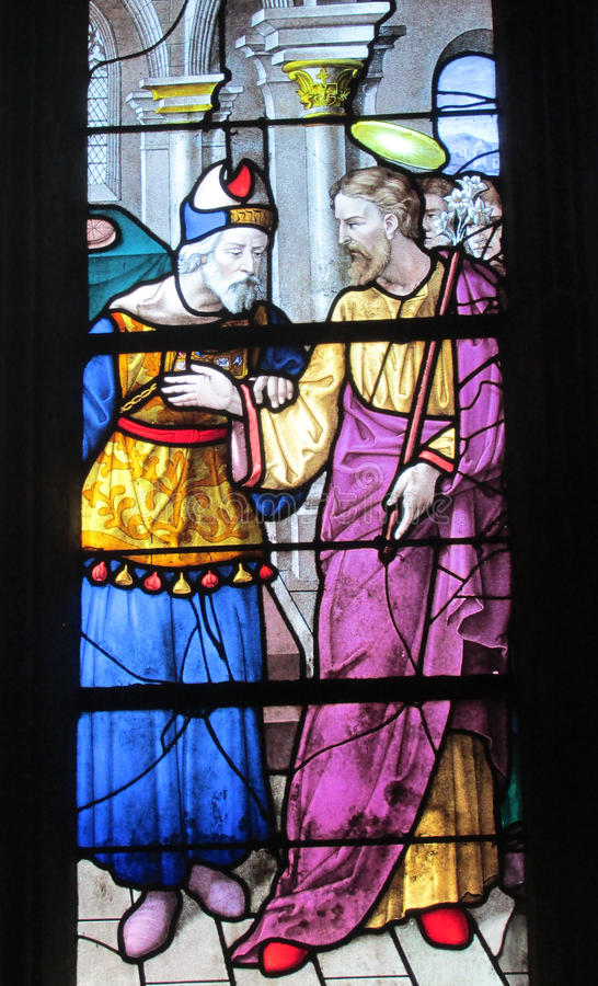 Religious picture on stained glass in the church royalty free stock photography