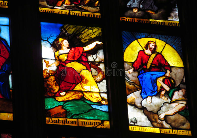 Religious picture on stained glass in the church stock photos
