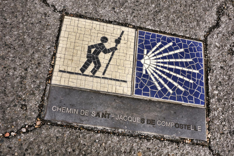 Religious Pilgrimage Station Route Marker. Way of St James Route leading to Santiago de Compostela sidewalk marker in French as Saint Jacques de Compostelle stock images