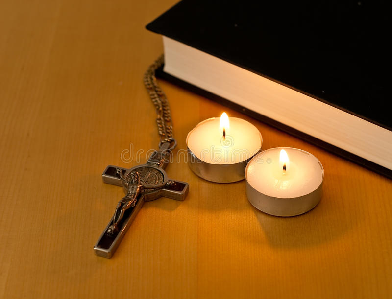 Religious Practice. Concept Image With Cross, Bible and Canndles stock images