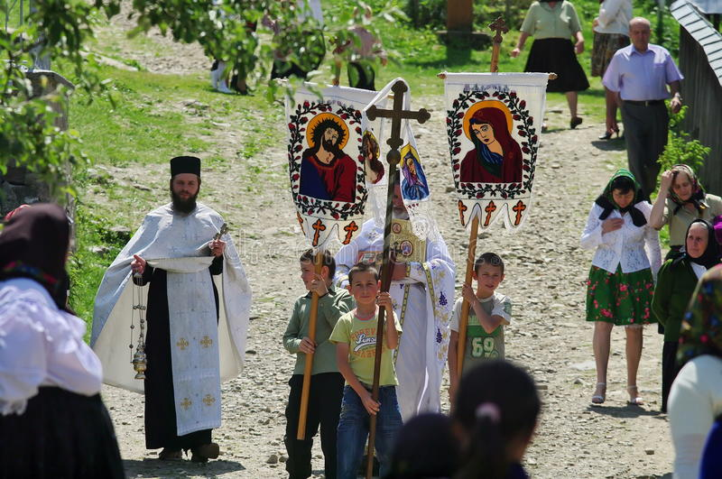 Religious procession in Maramures, Romania. Orthodox priest stock images
