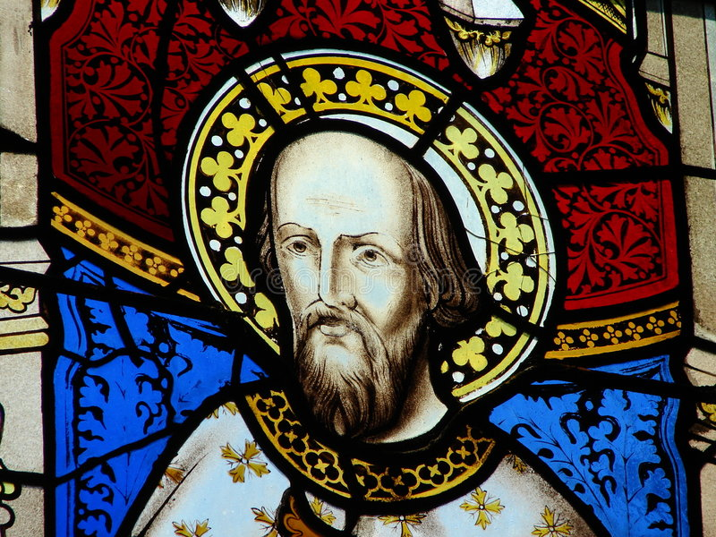 Religious stained glass window. Colorful biblical figure on religion stained glass window in church stock image