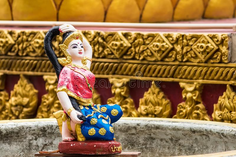 Religious statue at fountain, Thailand. Mother Earth Squeezing Her Hair stock photos