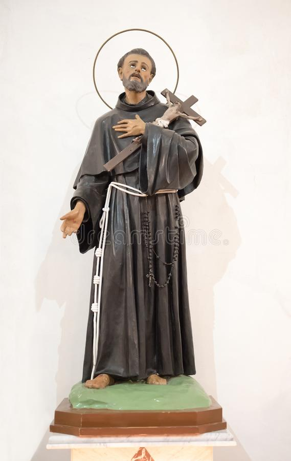 Religious Statue of Saint Francis of Assisi. Patron saint of animals and nature and founder of the Franciscan Order over a white background stock image