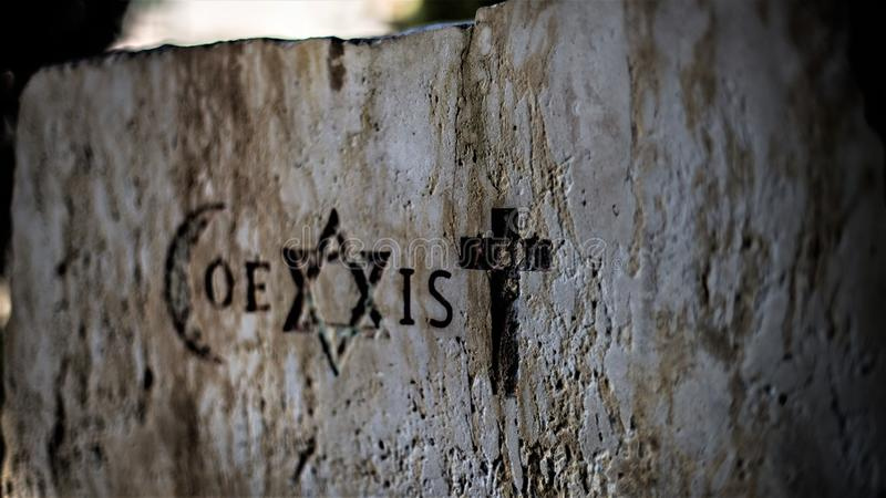 Signs and religious symbols of the Coexist movement. Religious symbols representing the 3 monotheistic religions: Muslims, Israelites and Catholics. Coexister is royalty free stock photography