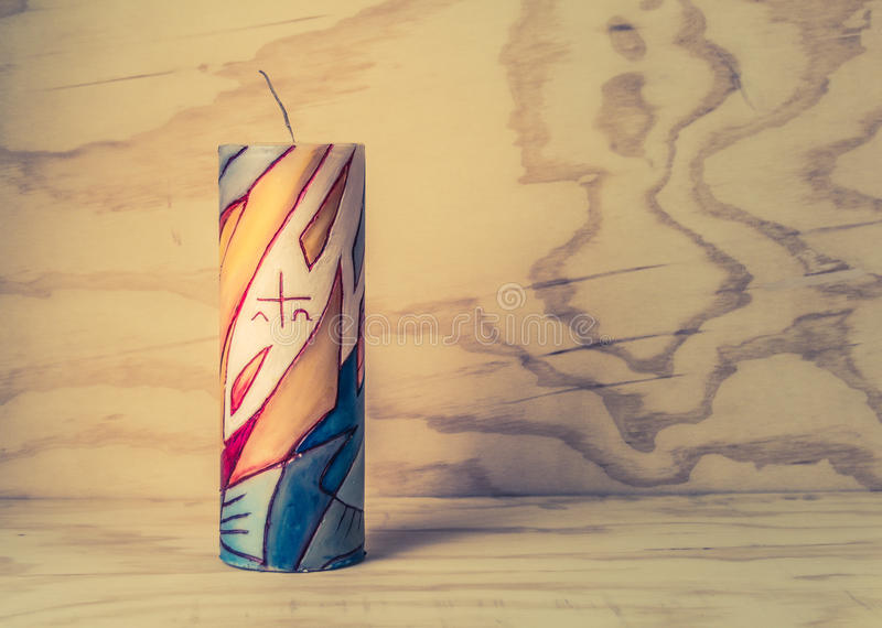 Religious wax candle with symbols. Photograph of a religious wax candle with symbols stock photos