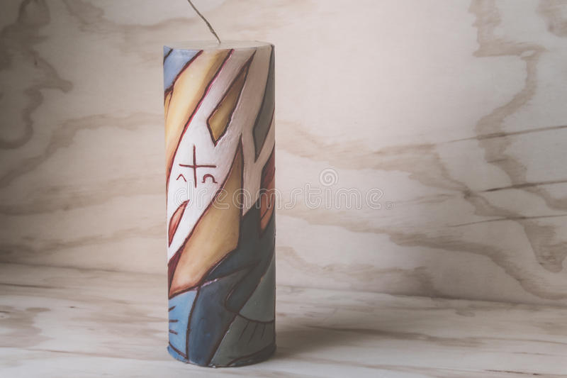 Religious wax candle with symbols. Photograph of a religious wax candle with symbols royalty free stock photos