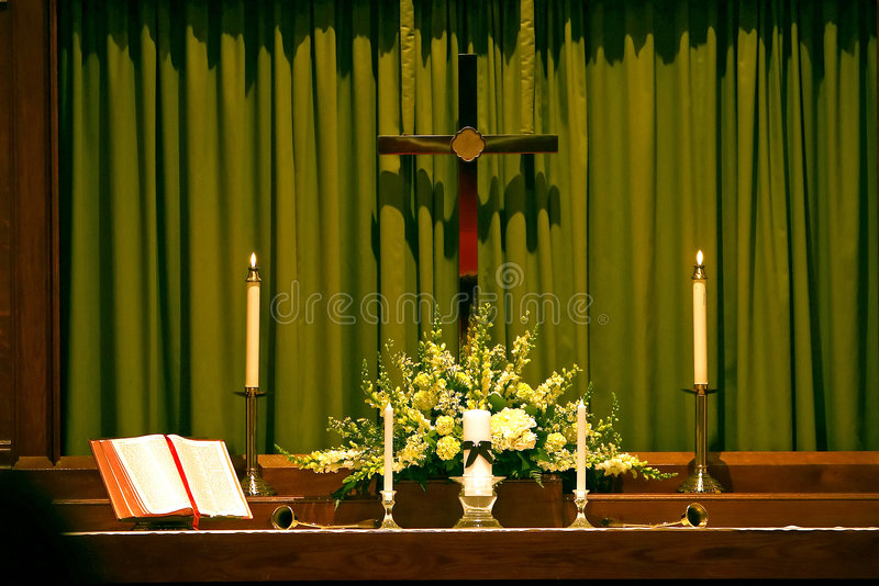 Religous Altar with Bible, Cross and Candles royalty free stock photography