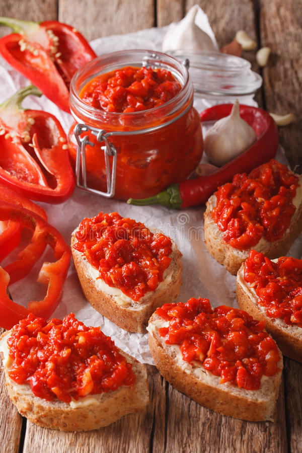 Relish (Ajvar) of Roasted Red Bell Peppers on toast slices close royalty free stock photography