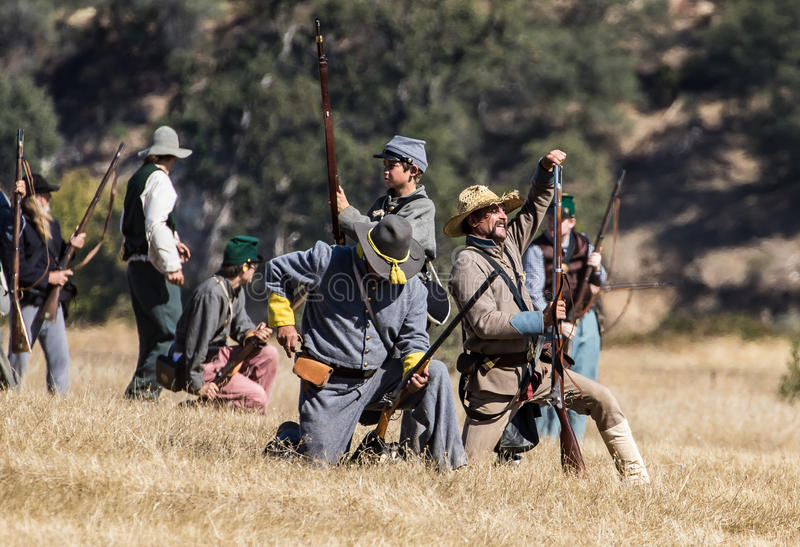 Reload. Civil War era soldiers in battle at the Hawes Farm reenactment in Red Bluff, California stock images