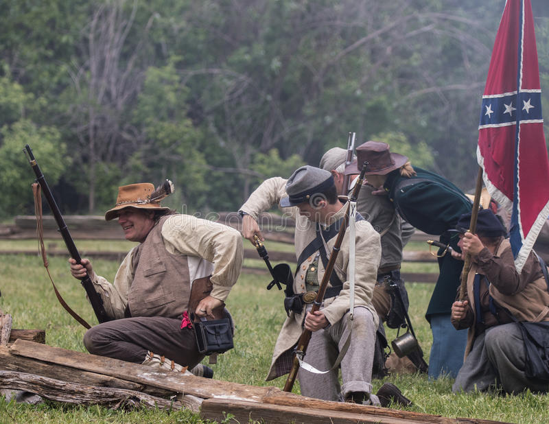 Reload and Heads Down. Civil War era soldiers in battle at the Dog Island reenactment in Red Bluff, California royalty free stock image