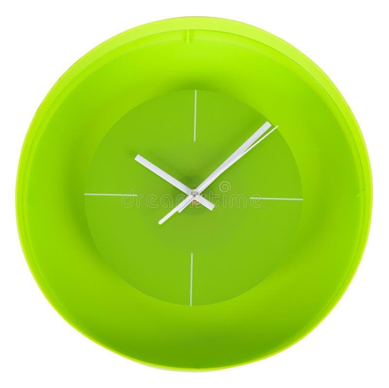 Reloj clásico verde en una pared blanca libre illustration