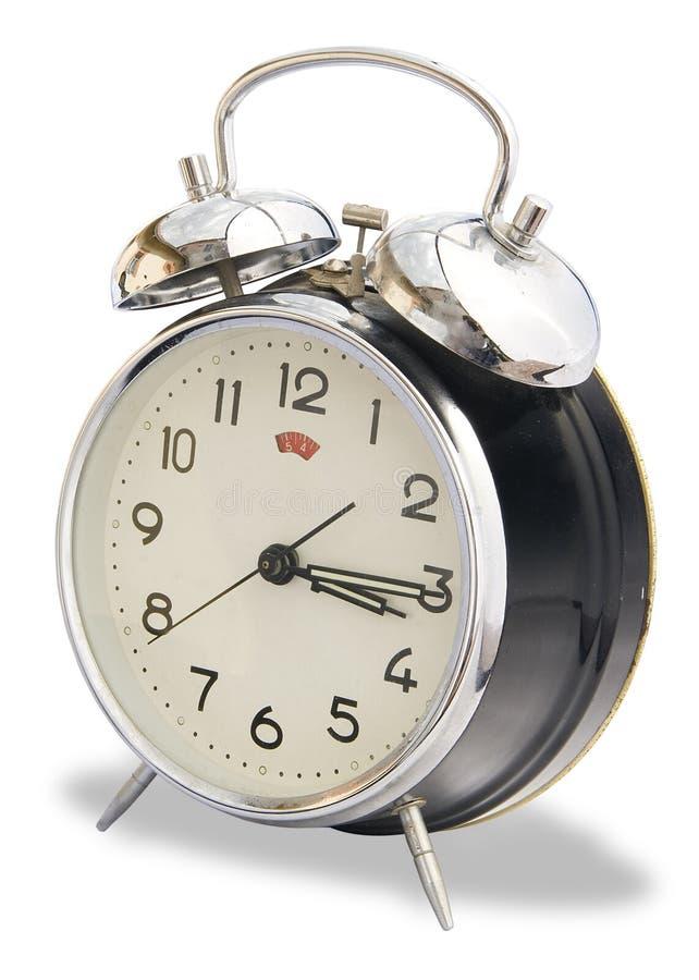 Reloj de alarma aislado de la obra clásica de la vendimia fotografía de archivo