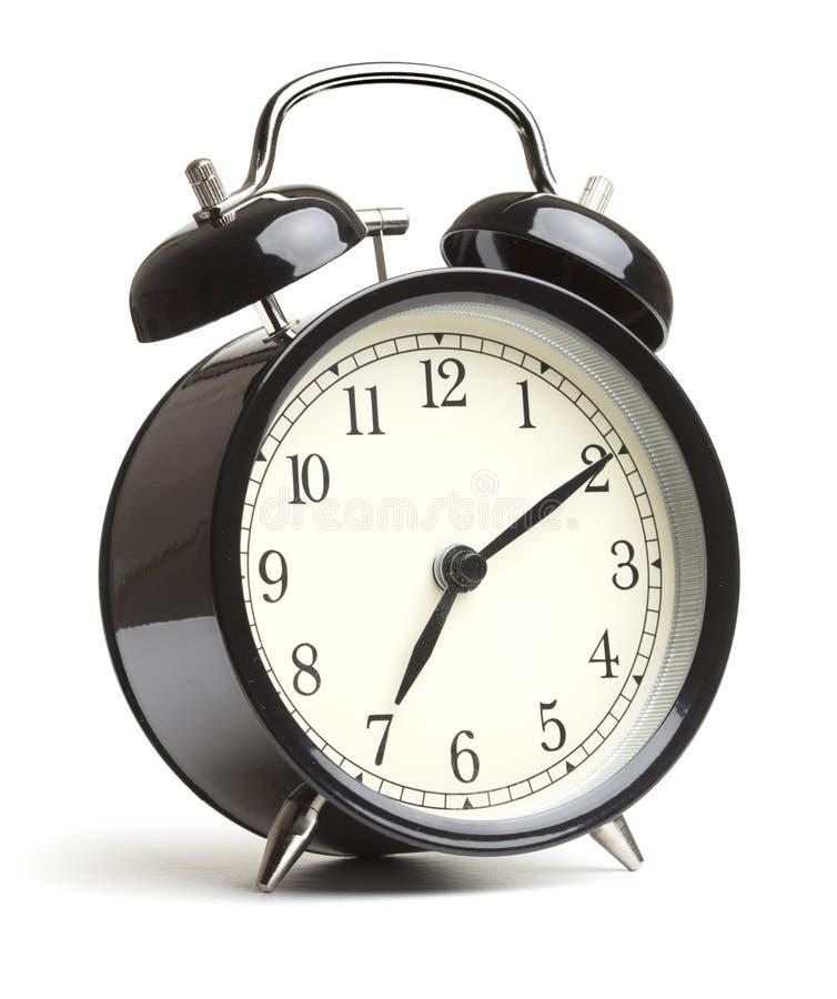 Reloj de alarma aislado en el fondo blanco imagen de archivo libre de regalías