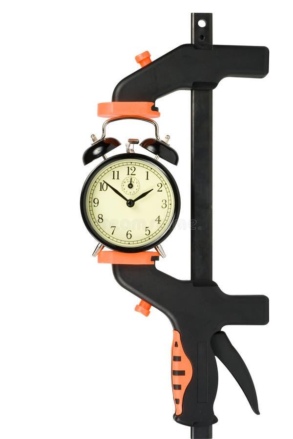Reloj de alarma embridado en una abrazadera manual imagen de archivo libre de regalías