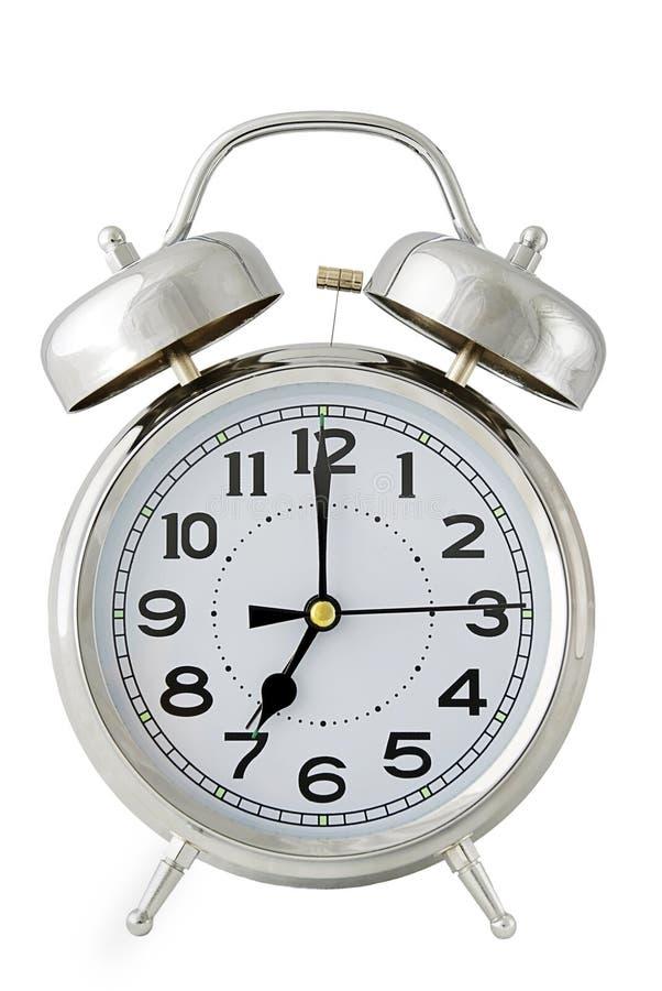 Reloj de alarma en blanco imagen de archivo libre de regalías
